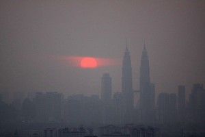 Kuala Lumpur is shrouded in acrid smoke from burning palm oil plantations. Photo Credit: Wikimedia Commons