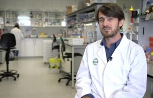 Plant researcher Oliver Van Aken in his laboratory. Photo Credit: YouTube screenshot