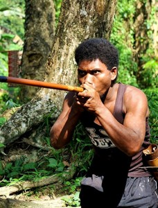 An Orang Asli man uses a blow pipe in the Kuala Woh Jungle Park in Tapah. Photo Credit: Truly Asia TV
