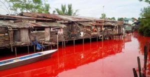 A river in Kuantan turns red during the bauxite mining fiasco in Pahang. Photo Credit: GERAM
