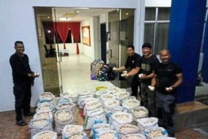 Officials in Sabah show off the thousands of turtle eggs they seized from smugglers. Photo Credit: Sabah Marine Police