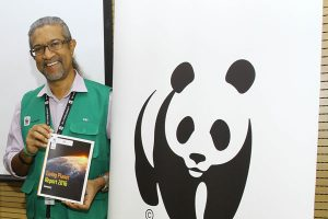 WWF-Malaysia's head Dionysius Sharma shows off the conservationist group's latest global report on the planet's wildlife. Photo Credit: WWF-Malaysia